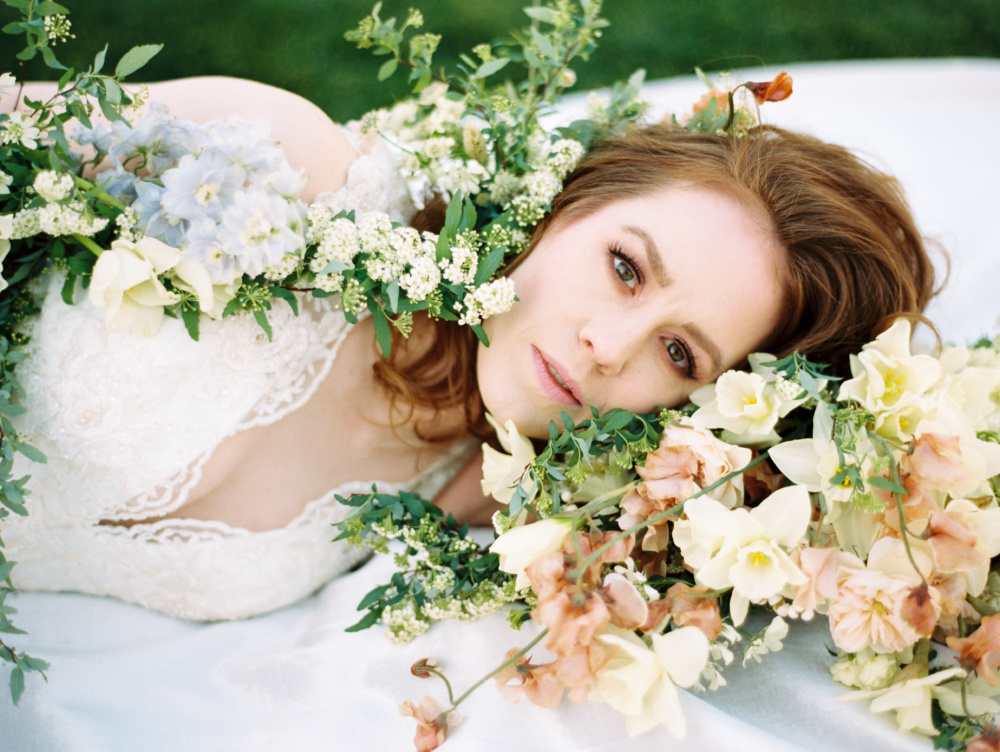 bride in bed of roses styled by melissa chataigne _ michael costa theia bridal